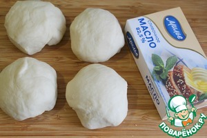 Divide the dough into 4 parts.  Divide butter into 4 equal pieces.