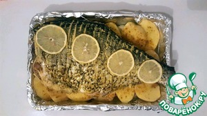 Place the fish on the potatoes, put on top of slices of lemon and put it in the oven for 50 minutes)
