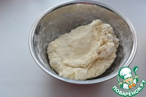 Start to knead the dough, gradually adding flour. It may take 3 to 4 cups. The batter should be tender and elastic.