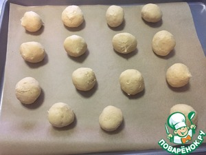 After 3 hours, remove dough and divide into small pieces. Roll into balls about the size of a walnut and put on baking tray lined with parchment paper.