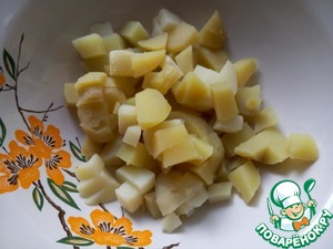 Potatoes peel and cut into small cubes.