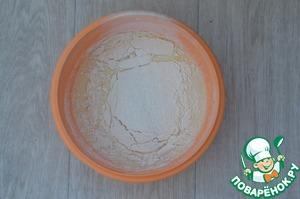 Add the sifted flour, baking powder, vanilla sugar (vanillin).