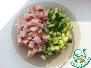 Cucumber and pork chops cut into cubes or strips.